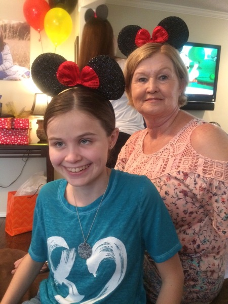 Aunt Kathy and I wearing Micky Mouse ears!